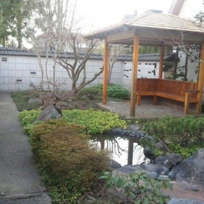 In the middle of the garden is a little pond with a stream, and a gazebo
